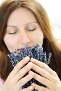 Woman inhaling lavender aromatherapy, MASSAGE Magazine Self-Care Tip