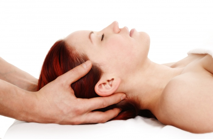 massage therapist addressing trigger point pain