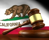 California Flag With Judge Gavel In Front For California Massage Law