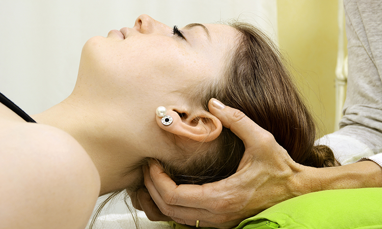 woman receiving craniosacral therapy
