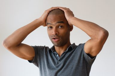 man looking overwhelmed by massage school choices
