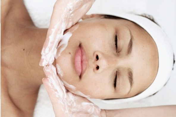 Elevated view of a young woman getting a facial