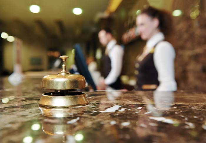 hotel front desk with bell
