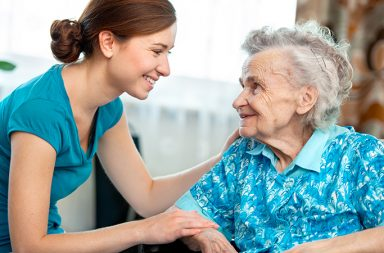 geriatric massage - younger woman with senior citizen