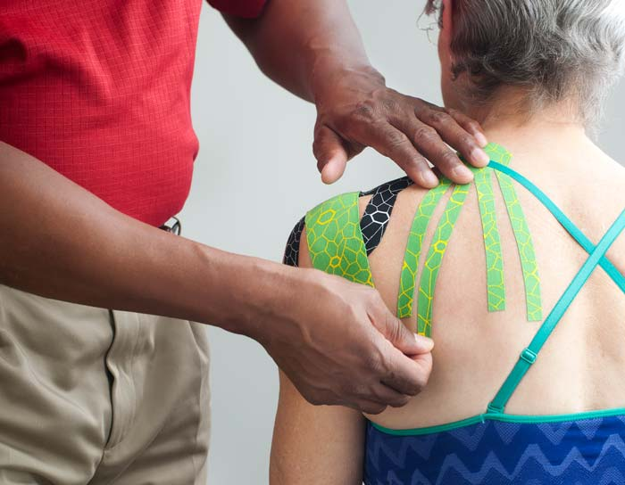 relieve pain with kinesiology tape