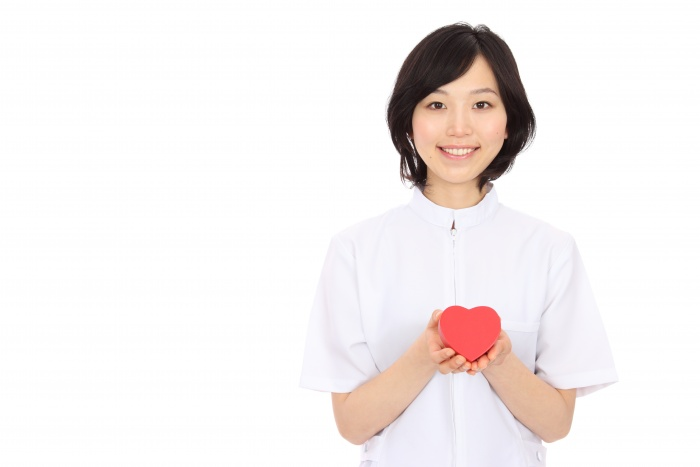 woman-smiling-holding-red-foam-heart