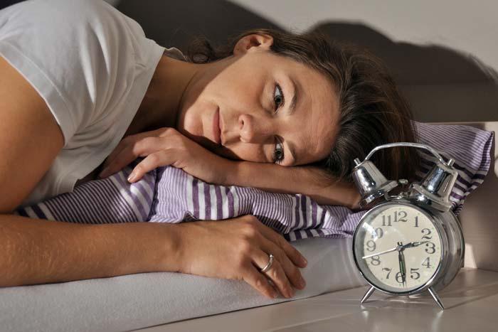 watching the alarm clock