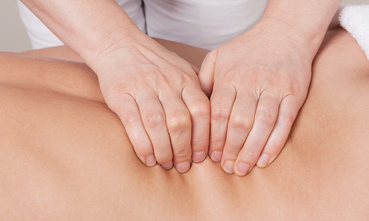 Client feels relief after getting a deep tissue massage