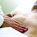 Massage Therapist Palpating the Abdomen