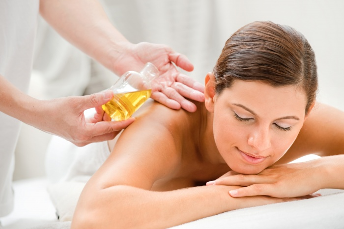 An attractive caucasian woman getting massaged in a spa