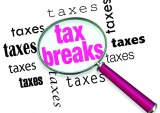 A Magnifying Glass Hovering Over The Word Tax Breaks, Symbolizing The Advice And Tricks That An Accountant Can Use To Increase Deductions And Save Money When Filing Tax Returns