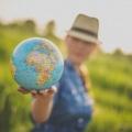woman holding globe - big zero waste idea