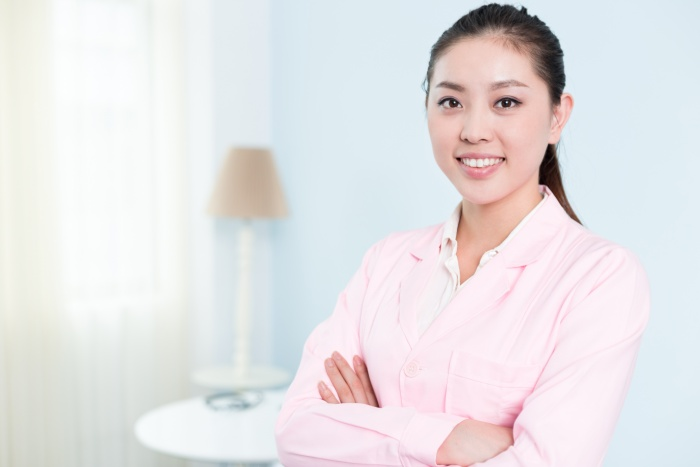 young pretty chinese woman nurse in hospital