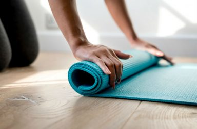 A woman about to start practicing yoga routines for massage therapists